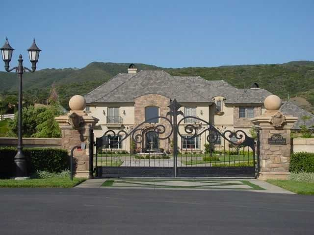 GEM OF THE VALLEY...magnificent custom Chateau nestled in the foothills on west side of Murrieta on 2 1/2 acres fully landscaped.Four beautifully appointed bedrooms suites with private baths plus three 1/2 additional baths,gym,office,formal dining room,bonus/game room,theater room,casita with separate entrance,great room,huge kitchen and nook. Drapes throughout home. Faux finishes and ceiling murals. Completely decorated from the inside out. Custom cabinetry with distressed finishes.Hard wood, travertine Equipment: Shed(s),Pool/Spa/Equipment,Range/Oven,Garage Door Opener. Exterior: Metal. Heating: Forced Air Unit. Patio: Awning/Porch Covered. Unit Location: Detached. Rooms: Guest Maid,Breakfast Area,Dining Area. Sewer: Septic Installed. Residential Styles: Detached. Water: Well on Property.
