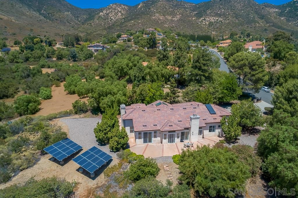 Beautiful Single Story home in desirable Skyline Ranch Estates. Expansive 12' ceilings, spacious 4 bed 3 full bath, 2590 square feet. Open concept kitchen and family room with fireplace, and, a formal living and dining room with its own fireplace for formal entertaining or second family / game room. Views from all sides of this 1.4 acre property with paid solar and a brand new roof. Enjoy the peaceful wind, trees and views. Close to all, 7 miles to Rancho San Diego, just 30 min to Downtown San Diego.  Skyline Ranch is a community of about 65 homes, most on lots of at least 1.5 acres. Enjoy well spaced tree lined streets and beautiful views of the Mountains, Valley and ocean on a clear day as you walk through the neighborhood. Nothing like being far enough away from the city to enjoy the quiet and stars, yet close enough for shopping and fine dining just a few minutes away. This single story home has 12' expansive ceilings spacious rooms and a very comfortable floor plan. Other Fees: 0 Sewer:  Septic Installed