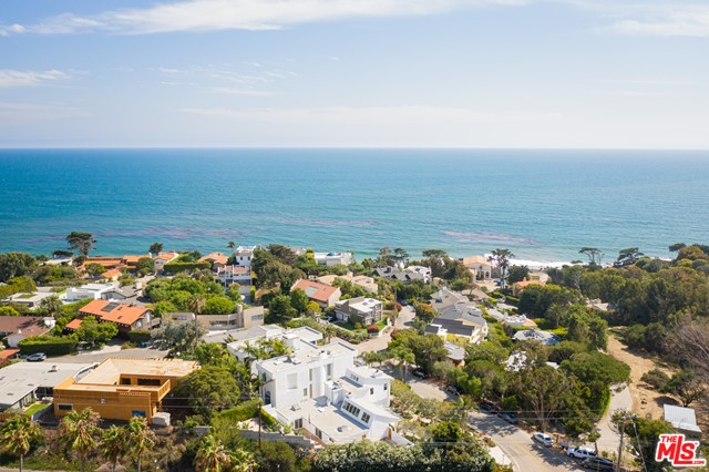 Incredible opportunity to own in one of Malibu's Most Prestigious communities, BROAD BEACH! This highly upgraded mostly 1 story home offers Ocean Views from one of the TWO Master Bedrooms! The only room upstairs is a full size master with walk in closet, separate tub and walk in shower. This upstairs suite will take your breath away! Upon entrance to the main floor you are immediately greeted with coastal architecture & fresh new colors. The entire property has been renovated from top to bottom. Upon arrival you will notice freshly paved parking & a half circle drive! The front & back landscape offer a tropical, coastal accent of succulents and drip irrigation. The curb appeal is stunning with rock formed retaining walls & custom drainage. The entire structure has been painted inside & out & the garage is complete with Epoxy Floors, high end cabinets, custom finishes & more. Many other upgrades & just a SHORT WALK to the BEACH! One owner past 20 years! Spotless move in ready!