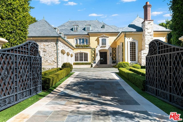 The finest quality, substance & style embody this grand Traditional Manor poised on an over 21,000 sq.ft. lot on one of the most prestigious streets in prime Brentwood Park. Set behind majestic double front gates, this world-class estate w/apx. 15,500 sq.ft. of living space is extremely private & offers an enchanting setting w/meticulously manicured grounds, captivating faade & timeless authenticity. This estate provides an exceptional lifestyle w/the quality & amenities equivalent to a superlative five-star hotel. The main level is complete w/impressive formal foyer, formal living rm, library, formal dining rm, family rm & gourmet kitchen w/breakfast rm. 5 family bdrm suites upstairs & the magnificent master suite w/fp, terrace, onyx bath & custom closets/dressing rms. The lower level features billiard rm w/bar, wine rm, movie theater, gym, laundry rm & staff apartment. The rear grounds are completely private w/towering hedges, patios, lawn, pool, spa & detached pool/guest house.