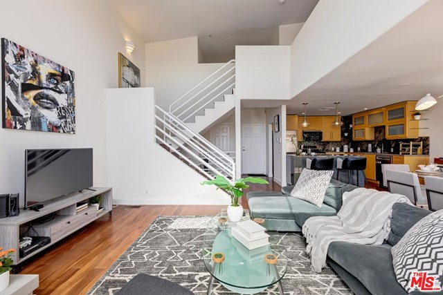 Welcome home.  This is a one of a kind opportunity to purchase one of the largest 3 Br, 2.5 bath, plus loft townhouses, located near the Pacific Ocean and close to all that Santa Monica has to offer.  This immaculately presented, bright and airy penthouse features floor to ceiling windows, with a spacious open floor plan, hardwood floors on the main and loft levels, modern kitchen, soaring living room ceilings with wood burning fireplace and a dining room  that opens to a balcony. Newly installed central air. The lower level includes a primary suite, 2 additional bedrooms with hall bath and full size washer/dryer in laundry and abundant closets. The loft area is perfect as a home office or den and opens to a second spacious balcony with beautiful views of the city.  Gated entry and side by side parking in the garage of this 6 unit building.