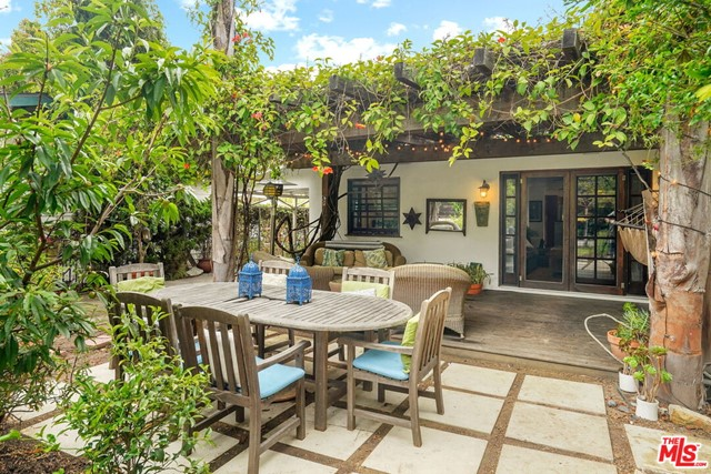 Spanish compound with a spectacular garden featured in the Venice garden tour on numerous occasions. Located blocks from famed Abbott Kinney and Rose Ave. Spacious and light filled 3 bd 2 ba has a large open floor plan with a recently remodeled kitchen with granite counters, farmhouse sink, marble backsplash, breakfast bar, Stainless steel appliances and wine refrigerator. Breezy Master leads to back secluded patio area through French doors complete with children's play house surrounded by bamboo. Remodeled master bathroom with marble counters and twin sink vanity and large walk in closet. Light filled living room leads to large wood deck with Trumpet flower vine canopy overlooking a lavish garden complete with citrus trees, vegetable garden and buffalo grass lawn. Too many exotic plants to list. A truly relaxing and harmonious property. Large RD1.5 Lot so room to expand in the future or ADU. Exceptional Airbnb history, just call and ask! Not only is this a great place to call home  but a great investment that will bring you huge returns.Use as a vacation rental income producing home, or a 2nd home near the beach!