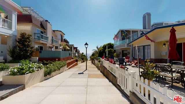 Live the quintessential beach life on one of the most desired walk streets in Manhattan Beach. This ideal location, on sunny side of the street, is far enough away to never hear associated traffic noise yet footsteps to all the city has to offer. Top of walk-street you'll find stairs leading into Live Oak Park recreation facilities with the opposite end of street leading to most spectacular section of the beach. This 3 bed 2 bath has a 2 car garage plus an additional parking pad and is well maintained with beamed ceilings in the den, unique custom designed composite, glass kitchen counters & breakfast bar. The open floor-plan opens up to the large walk street patio designed for enjoyment with built in gas beach style fire pit and beautiful ocean views and breeze. Live and enjoy for as long as you desire, and when you are ready, enjoy one of the premier positions in all of Manhattan Beach. There is only great upside on this rare investment opportunity.