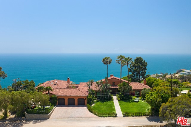 With wraparound views and sensational cul-de-sac location, this private Mediterranean estate invites tranquil living and lavish indoor-outdoor entertaining. Grand entry hall, ocean-view living room with cathedral ceiling, picture windows, fireplace, doors to ocean-view balcony with seating. Family room/library with fireplace and balcony. En-suite bedroom has glass door to front yard. Formal dining room has three glass doors to front yard. Spacious den/lounge opens to another balcony. Skylight kitchen has large island, bar seating, stone countertops, butlers pantry, glass doors to central courtyard with outdoor kitchen, pizza oven, grill, fountain, built-in seating. Exceptional owners suite offers ocean views, spa-style bath, huge custom closet, balcony. Second living room has powder room and doors to patio. Additional en-suite bedroom on same hallway. Lower-level laundry room and large mirrored gym with doors to backyard. Beautifully landscaped and terraced grounds, with tiled patios, waterfall, pool/spa deck, covered sitting area with built-in couches, covered lounge with fireplace, lawns, orange trees, and multiple areas for relaxation and dining. En-suite space accessible from backyard could be office, art studio, or guest suite. A remarkable property that includes deeded Rambla Pacifico Road access and La Costa Beach and Tennis Club membership.