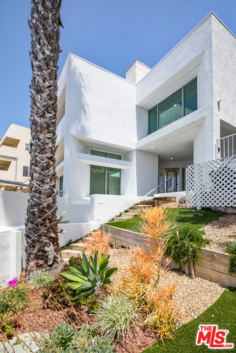 Welcome to this completely renovated contemporary home with whitewater ocean views in the coveted La Costa Beach neighborhood. This split-level home was designed to capture the ocean views from almost every room. Featuring 3 bedrooms with 2.5 baths, hardwood floors, and multiple skylights with an abundance of natural light. Sunken living room with fireplace and a large deck creating an indoor-outdoor flow with coastline ocean views in the background. A gourmet chef's kitchen with all brand new appliances including a beverage center. An expansive master suite with ocean views and lots of closet space and a brand new washer/dryer. High-speed internet with built-in entertainment center and security monitoring system. Freshly landscaped backyard with in-ground spa and an outdoor shower designed to maximize the Malibu Lifestyle. Optional membership to Malibu's most sought-after private beach club, La Costa Beach and Tennis Club.