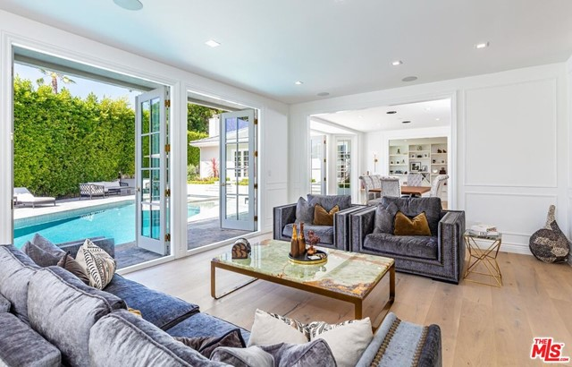 Beautifully remodeled and secluded behind gates on a quiet cul-de-sac in the coveted Beverly Hills Post Office. The expansive layout features a formal entry, chef's kitchen with walk-in pantry, study, and a media room with a top-of-the-line recording studio. Double french doors throughout create an effortless indoor and outdoor flow making entertaining seamless. The stunning primary suite is its own retreat with dual walk-in closets, spa-like bathroom, and a private veranda with lush views. This sophisticated estate offers privacy with ease of access to the heart of Beverly Hills.