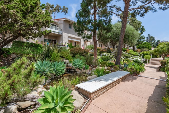 Desirable upgraded unit in the gated Malibu Villas community. Open plan dining room, living room, and kitchen with 20' vaulted ceiling. Lots of natural light from windows on all sides. Stone fireplace. Glass sliding doors lead to a balcony with peekaboo ocean views. The kitchen features stainless steel appliances, granite countertops, and a stone backsplash. Downstairs is a second bedroom with ensuite bathroom and sliding doors leading to its own private patio. Large master suite has its own balcony with a beautifully appointed bathroom with his and her vanities, stone floors, and a large walk-in closet. The home has white oak hardwood floors throughout, plantation shutters, nest controlled A/C, an attached 2 car garage. The guard-gated community offers a pool, spa, rec room, maintained landscaping, and ample guest parking. Paradise Cove Beach is within walking distance and close by is Point Dume Village where there's a Pavilions and Starbucks. Pepperdine University is 10 min away.