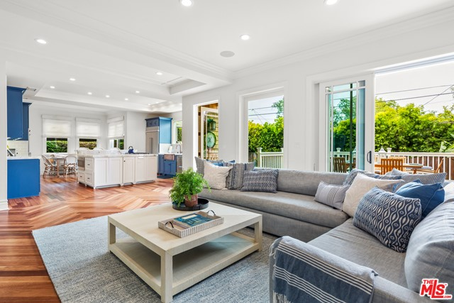 Updated in 2019, this Pacific Palisades shingle-style home blends traditional design w/ natural materials. The front porch welcomes you to a spacious foyer. The Brazilian wood floors exude warmth as you move through the home. Step down into the formal living room with dramatic windows that enhance the ceiling height. Phillip Jeffries' wall coverings & a Fortuny chandelier bring a magical ambiance to the formal dining room. The well-appointed kitchen offers a copper farmhouse sink, opalescent granite countertops, an expansive island, & a large walk-in pantry. The kitchen opens to a breakfast area and gracious family room, which connect to the back deck and grassy yard. A first-floor bedroom suite allows guests to rest comfortably or is an ideal office. A sweeping staircase leads to the home's private quarters where you will find a master bedroom w/ a luxurious en-suite bath. The master balcony features peek-a-boo views of the Queens Necklace. Three additional bedrooms surround a central airy & open 2nd story living room. Gather, play or create a fabulous office with more peek-a-boo views of the Pacific. This exceptional home also offers three fireplaces, an upstairs laundry room, & direct access two-car garage w/ extensive built-in storage & finished floors. Close to the beach, hiking trails & Caruso Village. Welcome home.