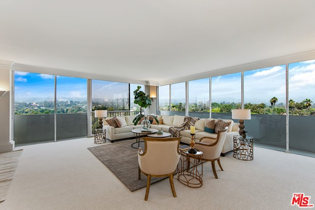 Wonderful opportunity to own a 3 bd, 3ba unit in the full service Wilshire Holmby.  This light and bright 9th floor unit faces away from Wilshire and has huge wrap-around windows to see the breathtaking north and east views of Bel Air, UCLA and the Getty.  The third bedroom is currently opened up and being used as a den adjacent to the living room.  This makes the living space HUGE for entertaining.  The master suite is on the opposite size of the unit from the second bedroom for privacy.  Master bedroom has lots of closets and ensuite bath with granite counters, separate tub and shower. All electric kitchen.  Parquet wood floors in the hallways and kitchen, new carpeting and recessed lights.  Cable & internet included in HOA dues. 24 hr security and valet, pool, gym, rec room with kitchen.  Warner Ave. Elementary School.
