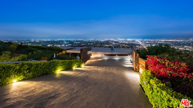 Views, Views, Views! Privately gated, Hollywood Hills contemporary estate with unobstructed city views. A large, private, gated driveway welcomes you inside to a stunning work of architecture, custom built with the highest luxury standards and finishes. The open floor plan highlights the grand scale of this one of a kind villa, with 3,500 SF of outdoor decks and patios, showcasing the explosive views and the indoor/outdoor California lifestyle. Lower level includes four large en-suite bedrooms and a spectacular 1,500 SF zen master bedroom suite with fireplace, walk-in closet and dual bathrooms. Other amenities include beautiful marble floors inside and out, high ceilings, fleetwood windows, media room with a bar, movie screen, two steam showers, infinity pool, spa, waterfall, built-in grill & outdoor bar, european kitchen, Miele appliances, smart home technology, surround sound, security system with cameras, luxuriously furnished, complete with an automobile turn table, 5 car garage and space for 10+ cars on the driveway. Features are too many to list, must see in person.