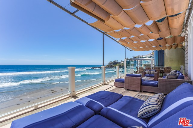 Just reduced! This thoughtfully designed home is the ultimate beachfront  offering with open light-filled living spaces and the perfect blend of great gathering areas, private retreats and spacious oceanfront balconies. With direct access to the sand, take in the awe-inspiring views of Lechuza Cove, Point Dume, Catalina and beyond. One of the largest residences available on Broad Beach, this true retreat has stunning high-end finishes and embodies a quintessential yet sophisticated beach style. A spectacular oceanfront 3 room master suite with soaring 2 story ceilings awaits and includes a private whitewater view deck, an attached retreat area with warm fireplace, gym/workout loft and 2 over-sized built-in closets. 5 additional bedroom suites, 4 featuring panoramic ocean views, with private baths and large closets await your guests and family. No detail has been overlooked including an elevator, 3-car garage and off-street parking for an additional 3 vehicles.