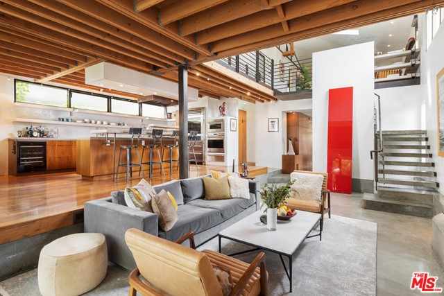This exquisite one-of-a-kind property has been re-imagined by esteemed local architects David Hertz and Charles Ward and is for the most discerning of buyers. With architectural features such as exposed wood beams and ceilings, sleek steel finishes, polished concrete and wood flooring, a loft-style secondary lounge area upstairs, and custom architectural glass doors and windows. Natural light floods into the open living and dining areas through the surrounding floor-to-ceiling glass windows and doors. The chefs kitchen offers an ultra-modern design using open shelving to accentuate the open atmosphere and provide plentiful storage. The primary suite comes complete with an open terrace that spans the entire width of the second story and looks out to the picturesque backyard, where youll find luscious greenery, and a beautiful spa and swimming pool. Also featured in the backyard is a second structure that serves as a bar and gym, and will have completed the plan check process for an ADU to have an RTI Ready To Issue status. Centrally located to Abbot Kinney, the beach, and all Venice has to offer, this private oasis is a must see!