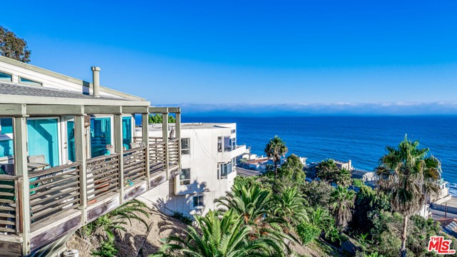 Drop dead gorgeous ocean views from this lovely hillside home with stylized architectural flair.  Includes attached guest unit with separate entrance.  Perfectly situated and within easy reach of downtown Malibu, Pacific Palisades and Santa Monica.  Includes membership in the highly-coveted La Costa Beach and Tennis Club. Broker and Broker's Agents do not represent or guarantee square footage, bedroom/bathroom count, lot size or lot dimensions, permitted or un-permitted space, or renovations. It is Buyer's sole responsibility to perform investigations and satisfy themselves. La Costa Beach Club's optional yearly fee is $7,100; Tennis is an additional $150.