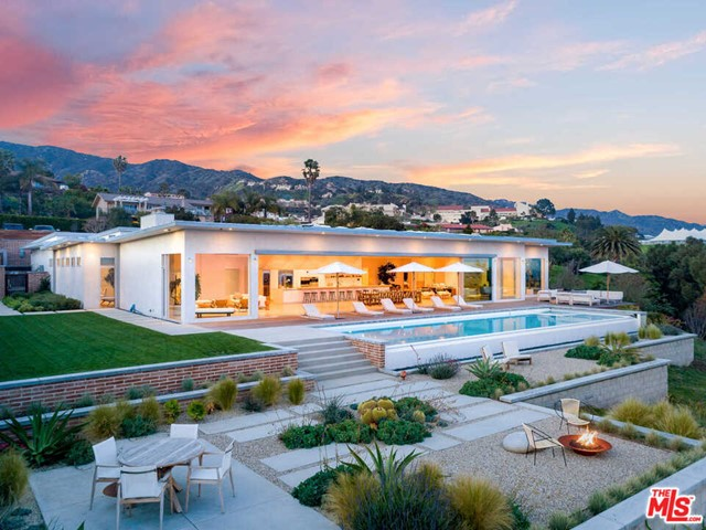 Built in 2015, this private estate is located just minutes from Cross Creek, Malibu Country Mart, world-class beaches, hiking, and the finest shopping and dining Malibu has to offer. A single-story contemporary, this showcase home boasts 13' high ceilings, expansive open spaces, and walls of glass throughout. The massive 4,000 SQ. FT great room opens up to a 60' long infinity-edge pool which seems to drop into the Pacific Ocean. Custom designer furniture throughout, Fleetwood windows, white oak floors, exposed wood beam ceilings, and a gourmet, state-of-the-art Bulthaup kitchen are some of the many ultra-high-end features. Retire from your days in one of 4 ocean view bedroom suites, which include a beautiful primary suite with a large ocean view primary bath. The home includes a 3 car garage, private gate, and camera security.