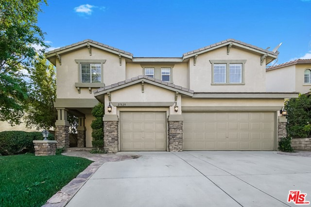 This Castaic two-story home offers a patio, quartz countertops, and a three-car garage.