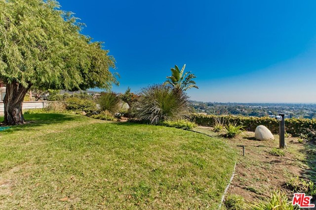 First time on the market in over 50 yrs!  Incredibly rare opportunity to build your dream home from the ground up or remodel the existing mid century 4 bedroom home with beautiful ocean views! Prior to confirming showings, we must receive signed CAR Form PEAD-V. (Coastal Commission applies to property.)