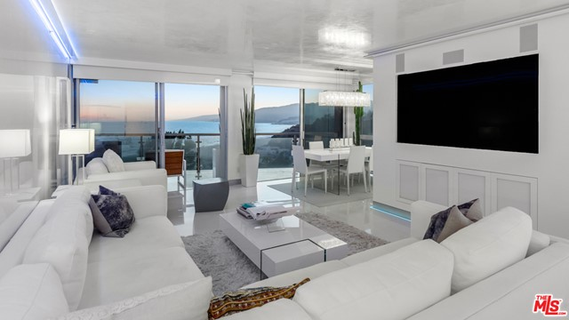 Once in a lifetime opportunity to own the best unit in the building. Completely reimagined 3 bed/2.5 bath. 180 degree panoramic views from the Ocean to the Canyon. Top of the line designer kitchen with all Miele appliances, Miele built in cappuccino machine and white Carrera Italian fine slabs.  The walls and ceiling were done with fine Italian white porcelain to capture the double ocean views. Remote control Lutron lighting system, LED with surround sound, RGB mood lighting and electronic window shades. Master suite showcases electronic doors that open up onto your unobstructed ocean view.  5-star amenities including Valet Parking, 24-hour security, Concierge service, Pool, Gym and Spa. Steps to the beach and world famous restaurants.