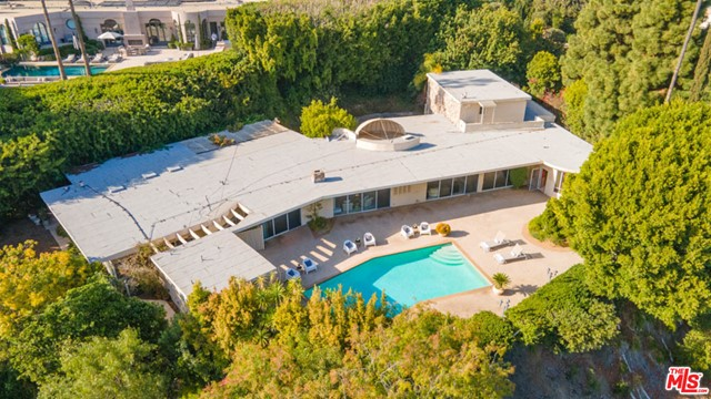 Available for the first time in over 55 years! One of the most significant properties in the neighborhood! 1111 Shadow Hill is the former estate of Mel Torme & Zeppo Marx. This exquisite single level home sits on a knoll & boasts a HUGE lot just a hair shy of 27Ksqft, with about 14Ksqft flat. The lot has a magnificent motor court & mature trees that provide a rarified secure/private lifestyle. As you step inside, tall ceilings & gorgeous terrazzo floors are bathed in natural light. Stroll into the backyard and look out at one of the most desired views in the city of Beverly Hills. Completing the spectacular grounds are a lovely pool w/ detached pool house. All of this in the most superb location perched just above the Beverly Hills Hotel, a skip away from Rodeo Drive shopping & a walk away from Coldwater Canyon Park. Its easy to imagine lavish parties here with all of Hollywoods elite.
