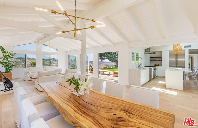On a quiet cul-de-sac in the prestigious Malibu Park neighborhood, this beautiful contemporary ranch offers expansive vistas of Bonsall Canyon and the Pacific Ocean. Extensive renovations have rendered this home a modern sanctuary for indoor/outdoor living with floor-to-ceiling bi-fold doors throughout and a verdant park-like backyard. Enter a bright, airy layout with wide-plank hardwood floors, vaulted ceilings, skylights, and an exquisite kitchen with adjoining family room as well as a primary suite with backyard access, canyon views and space to create a dream custom closet. On the expansive grounds, discover a garden studio/office, home gym and hen house as well as room for a potential pool. Only moments from Zuma beach and nearby trails.