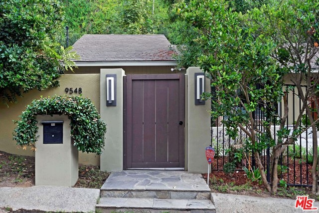 Nestled on a quiet street off plush Coldwater Canyon, this 3 bedroom, 4 bath gem offers you serenity in 90210, one of LA's premier locations. Relax w/family, friends and grab some rays on the secluded front lawn or unwind in the jacuzzi nuzzled next to a five-tier waterfall. The kitchen w/breakfast nook is adorned w/top of the line appliances and a spacious, adjacent dining room. A sizable and bright living room with fireplace, den, multiple outdoor lounging areas, built-in wine cellar and barbecue make this house ideal for entertaining. Large primary bedroom and bath w/backyard access, much like the secondary bed and bath which lead to the patio w/spa. A wonderful home for families and for fun! Probate Sale, subject to court confirmation w/overbids.