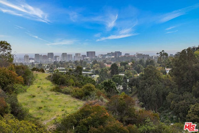 Fantastic Development opportunity with views, gated, and a large flat pad just minutes from the Beverly Hills Hotel. Unprecedented almost 2-acre lot with existing guest house and allowable square footage for an additional 10,000 sqft house. Build a multimillion-dollar house with views up a long driveway with a guest house and gatehouse minutes from Rodeo dining and shops. Bring all developers!