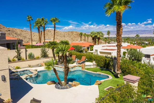 Magical Mirage Cove ~ A Hidden Gem of an Intimate Gated Complex of only 69 Single Family Homes on Terraced Pool Size VIEW Lots. This stunning home has been almost totally re-imagined in 2018-19 - Almost every surface has been tended to with quality workmanship - Nestled near the top of the hill - The 180 + Degree Views are ever-changing as the Sun bathes our Desert Paradise - One enters this home through twin Leaded Glass Entry Doors to the entry gallery - Your first glimpse of white marble-like ceramic tile flooring throughout - Turn right to the newly created Great Room - Living/Entertaining Areas with elongated skylight - AMAZING Gourmet Kitchen with Top Of the Line Meile Appliances - Semi Formal Dining Area taking in the VIEWS ~ This whole Area of the home faces North West to a Most Generous Outdoor PlayGround with Sparkling Swimming Pool with WaterFall and raised Spa with Spill Over ~ The Primary Bedroom Suite also opens onto this area so one can wake to a Sunrise Mountain View ~ The Primary Suite offers a Spa-Like Bath with Another Sky Light, Walk-In Closet, Twin Wall Closets and Water Closet ~ And Beat Goes On to the Junior En Suite Guest Area Totally Private - (Another Great Bath included here) On to the Third Bedroom with a Three Quarter Bath doubling as a Powder Room - Add a Generous Utility Romm with Newer SamSung Laundry Appliances - from here to the Double Attached Garage offering Lively Raspberry Epoxy Flooring and Built-In storage - Mirage Cove offers Two Tennis Courts - Community Pool/PartySpa and Two Pickle Ball Courts - One of the best locations in our Coachella Valley - Get almost anywhere within about 20 minutes. There is SO Much More to this home - Please take some time to study the Slide Show of Photos -