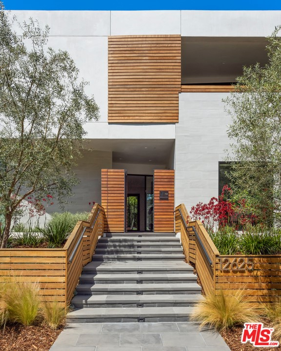 Located on a private cul-de-sac on one of Brentwood's most sought after streets, this architectural masterpiece offers modern, yet functional family-style living! Upon entering, you feel a sense of peace as the floor-to-ceiling glass windows flood the large scale rooms with natural light. This sophisticated 8,300sqft showstopper is personal and timeless. The finish materials and fixtures add the perfect dose of desirability to the mix. The main level boasts an enormous chefs kitchen with premier appliances and custom cabinetry. All main floor rooms open seamlessly to the private backyard where you can enjoy the ultimate entertainer's dream, including an incredible pool, yard, basketball court, and BBQ. Conveniently boosts two separate staircases as well as an elevator. Head upstairs to find an oversized master suite with two walk- in closets and a spectacular Venetian plaster master bath. Head downstairs to enjoy your very own wine cellar along with a private theatre and gym. This sensational home captures Brentwood's luxury living!
