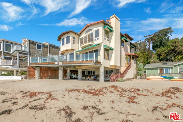 Incredible opportunity to live in one of the best locations in all of Malibu. This 3 story, 5 bedroom, 4 bath home sits on sandy Escondido Beach! Commanding coastline views from Palos Verdes to Point Dume. Large ocean front master and master bath that look directly to the bright blue ocean. Main floor combines high ceilings and open floor plan with living room, dining area and kitchen facing out to the beach. Large entertainers deck flows off living room and kitchen. Lower floor has guest bedroom, large office, full bath and laundry area. Sliders that open to second large shaded deck with direct access to the sand. Home is situated on private street and is completely gated with 2 car garage. Walk to Little Dume and Paradise Cove! ALL SHOWINGS TO BE MONDAY-FRIDAY BETWEEN11AM & 4PM (Buyer and buyers agent to confirm square footage and buyers responsibility to perform inspections.)
