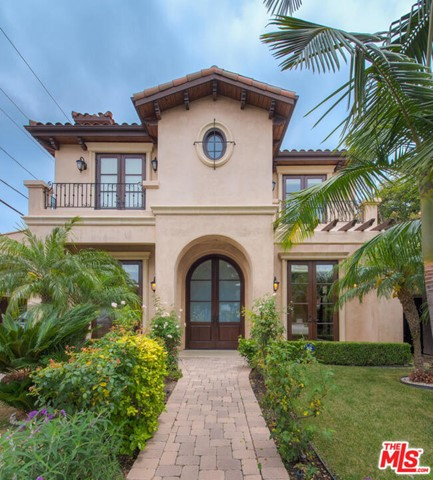 Grand Mediterranean Estate with a luxurious open floor plan located on a prime southern BH street. Formal entry with soaring ceilings to living and dining room. Exceptional custom chefs kitchen with top grade appliances that opens to an enormous den and private backyard with lush landscaping. Designer staircase leads you to four en suite bedrooms upstairs including grand suite with lavish bathroom, walk-in closet, and balcony. Hardwood, limestone floors with beautiful craftsmanship and quality throughout. Proximate to all the best that the city has to offer.