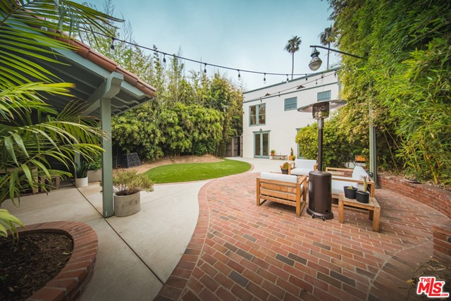 Lovingly restored 1920s Spanish compound in the heart of Venice. Surrounded by mature bamboo and sharing a generous 5600 sqft lot sits three character-filled units and a large artists studio w/ plans to become a Junior ADU (Unit #4). This private Venice oasis encompasses an exquisite 2+1 (plus den) upper-level unit, a private 1+1 lower level suite, a bright open 1+1 detached guest house, AND a sprawling artists studio/WFH with plans to become a Jr ADU. Owners and tenants alike can enjoy the expansive and lushly landscaped rear yard along with all the finer character details, from the oversized double-hung wood windows to the original hardwood oak floors. Fit with marble countertops, new appliances, tankless water heaters, and a separate washer/dryer for each unit, this property has it all and in the best part of Venice -- walkable to Abbot Kinney, Rose Ave, and under a mile to the beach! Guesthouse and Artist studio can be delivered vacant at close of escrow. The buyer can take over the permitting process that's already underway w/ architect drawings submitted to the city.