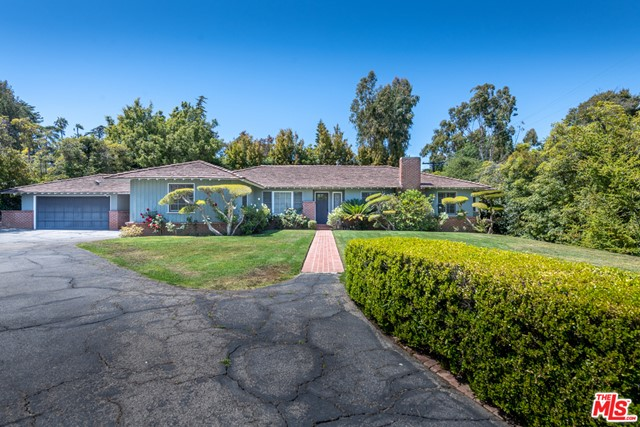 The original owner purchased the largest lot on the plat at 30,471 square feet of this Brentwood Park property and has remained in the original family since 1948.  There have been renovations along the way, and today, after meandering up a long private-gated driveway, you'll find a one-story 2,813 square foot ranch-style home with 5 bedrooms, 3 bathrooms and room for 5 cars within the two garages.