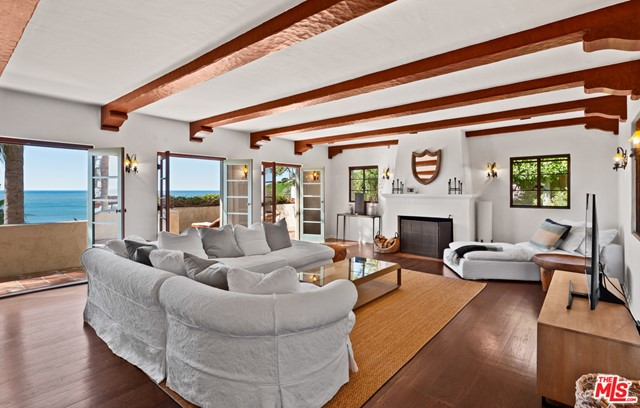 Reminiscent of a Spanish Villa, this 3-story home w/gorgeous panoramic ocean views is minutes to some of Malibu's most beautiful beaches. Located on a quiet cul-de-sac, the main level includes an ocean view formal living room w/FP, high wood beam ceilings & triple French doors to a viewing/lounging deck; an ocean view dining room that flows into a beautifully tiled kitchen w/breakfast room & an en-suite bdrm. The 2nd level offers a sun-filled, ocean view family/bonus room, an ocean view owner's suite w/FP, large closet, & claw tub/shower bath, plus 2-add'l bedrms w/Jack & Jill bath. The lower level, accessed by a separate entrance, has a large guest suite w/spa tub bath, kitchenette area & patio. The landscaped grounds w/grassy lawn area offers a generous lounging/dining area that is perfect lavish entertaining. There is a 2-car garage & street parking for guest. Deeded beach rights to La Costa Beach Club. Close to downtown Malibu, Pacific Palisades & Santa Monica. Available 10/01/20.