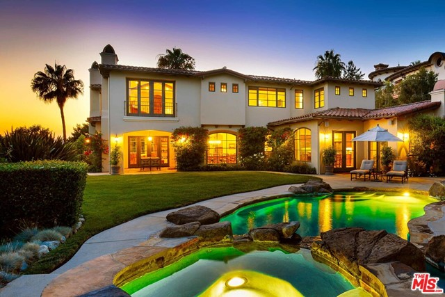 Designed by renowned architect Doug Burdge and built in 2005, this custom-built five-bedroom, six-bathroom masterpiece is one of The Highlands' most prestigious offerings. Ideally sited on the Chastain rim to maximize the explosive ocean and mountain views. The exquisite design utilizes the finest finishes and details featuring Pella windows, French doors, and beautiful wood and stone floors. A fabulous chef's kitchen opens to the spacious family room with soaring beamed ceilings, creating the perfect atmosphere for intimate moments or grand entertaining. The private master suite enjoys exceptional views that tower over the canyon towards the ocean. Dual spa-like bathrooms and a wood-burning fireplace complete this tranquil retreat. The resort-like backyard is beautifully landscaped and features a custom pool and spa, built-in Viking outdoor kitchen, and cozy loggia with firepit, all on a spacious, nearly half-acre lot.