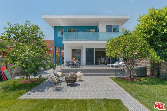 The perfect home for those seeking the beachy lifestyle without sacrificing the best of city living. Recently custom rebuilt for the owner from the ground up creating a garden paradise that captures the fresh ocean breeze and California sunlight. Indoor/Outdoor living blends excitement and functionality just 8 blocks from the beach and 1/2 a block from trendy Rose Ave. Come home from lunch at Caf Gratitude to this thoughtful and meticulously executed 6 bed/4.5 bath home flooded with natural light creating the ideal modern beach home. With 2 bedrooms on the lower level and 4 bedrooms upstairs, options for an office and/or den/playroom are plenty. The open floorplan features lovingly hand-picked finishes throughout including a Sonos speaker system, security cameras, 2 spacious upstairs decks, steam shower with body jets, outdoor shower and a large spa tub tucked under an orange tree for shade and privacy. This epitome of California living was custom designed and built with a mind toward entertaining. You can enjoy grilling from your professional natural gas grill or simply lounge in your spa tub or hammock overlooking abundant fruit trees and 4 organic garden beds while solar panels provide energy for it all.  The perfect oasis for someone who is looking for simple, green living in your own private resort!