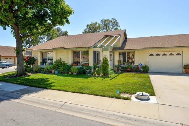 This beautiful home is located in Leisure Village, Camarillo's Premier Senior Community.  This is the highly popular Amalfi model - popular because of the den providing a room beyond the two bedrooms.  This home is surrounded by green, Mrs. Green Thumb lives here! The private patio is a tropical haven. As you walk through the updated, custom front door you will love the high ceiling in the living room and open, light dining room.  The kitchen has been updated over the years so nothing is original.  Just off the kitchen is the laundry area conveniently re-arranged for more space.  Both bathrooms have been remodeled and feature walk-in showers.  The master bedroom has additional built-in closet space that can be appreciated by anyone sizing down into retirement living. This home also features a deep driveway convenient for parking.  Come and see this nicely upgraded, garden beauty today!