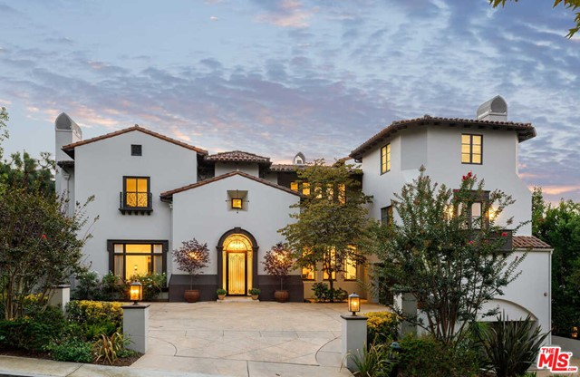 Situated in the prestigious, 24-hour, guard-gated Beverly Hills enclave of Mulholland Estates, this Contemporary/Transitional residence has been masterfully refreshed for the modern lifestyle. Offering absolute privacy & serenity, the approx 10,971-sq-ft estate captures far-reaching canyon & city views while providing unmatched amenities for entertaining. A spectacular 2-story entry leads to the formal living and dining rooms, family room with bar & stunning chefs kitchen with dual marble islands. Interiors segue to the resort-style backyard with an outdoor living room, fireplace, pool, spa & expansive grass lawn. Entertaining continues on the lower level, which features a nightclub, 13-person+ theater & a recording studio, which may serve as a guest suite. 7 bedrooms include the 2nd-floor primary suite with fireplace, spa bath, dressing room & balcony. Features include an office, library, 2 staircases, staff quarters, dual 2-car garages, spacious motor court & RTI home system.