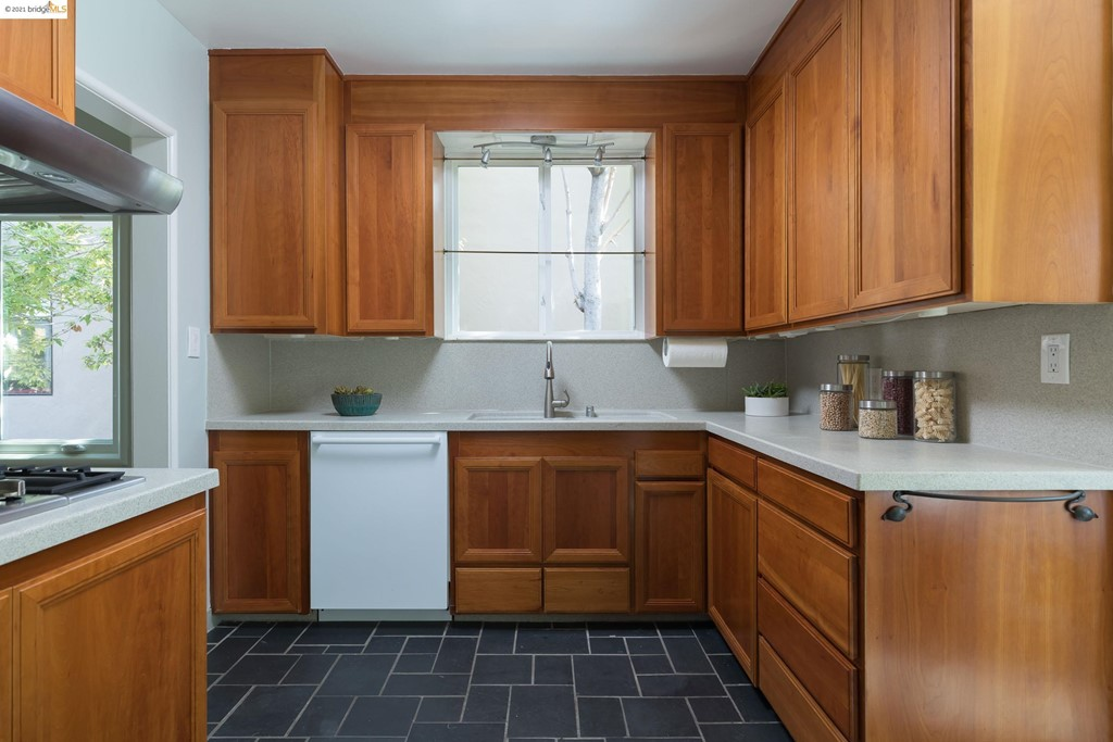 Corian counters, warm wood modern cabinetry, wall mount oven and gas cook top.