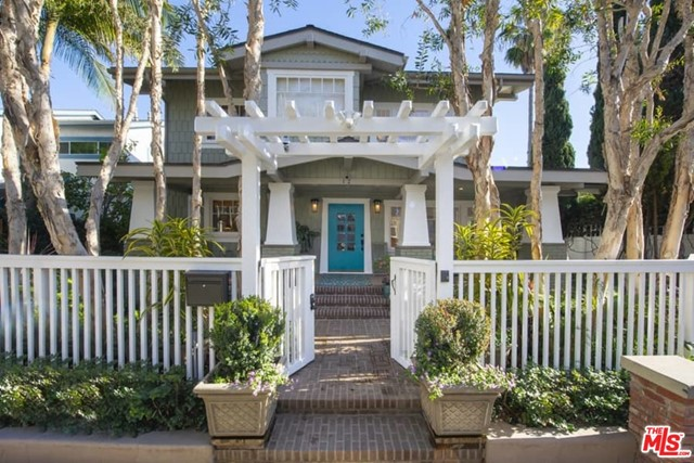 Located on a coveted walk street, steps from the beach & Shutters Hotel, this remodeled Craftsman w/ sep 2 bedrm gst house plus double 2 car garages is a rare offering. The main house includes 3 bedrms & 3 baths, w/ expansive ocn vus, plus wood flrs & voluminous light throughout. The gourmet kitcn provides a brkfst bar, Viking, SubZero & Miele appls & opens through a Dutch door to an outside dining area. The mster suite enjoys ocn vus & offers a sumptuous bath w/ marble counters & dbl sinks. There are 2 addl gst bedrms up which share a bath & a unique, cozy sleeping porch. The gracious public spaces include frml lving & dining rms, a den/media rm & powder rm. Expansive outdoor porches are augmented by professionally designed & landscaped gardens, which wrap around the entire house, providing lush entertaining spaces.  The 2 story guest house has a lrg great rm w/ fpl, a kitcn w/Viking appls & a bedrm & bath on the main level. Upstairs there is an ocean vu bedrm suite and porch w/fpl.