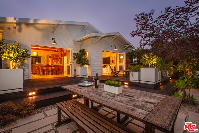 Located on one of Venice's  most exclusive walk streets, this astonishing architectural  craftsman features multiple indoor/outdoor spaces,  exceptional light, 4 car parking -- and a rooftop guestroom with private deck.   Numerous eco/ comfort features include a full home Lutron lighting system, radiant floor heating, HD/3D surround sound A/V system, full house SONOS audio system , full house water purification system, solar heating, Fleetwood accordion doors and for barbecue enthusiasts, an outdoor DCS barbecue.   An incredible list of modern features  continues with;  2 Jotul kitchen gas stoves, 960 sq.ft of outdoor decking. drought tolerant garden. and out door shower. Even the garage distinguishes itself with in-place 220 volt EV fast charger, red stainless steel cabinets by VAULT, and state of the art space saving racks  for boards  & bikes. NOTE:  Plans for a vertical exlansion of this home are available for inspection.