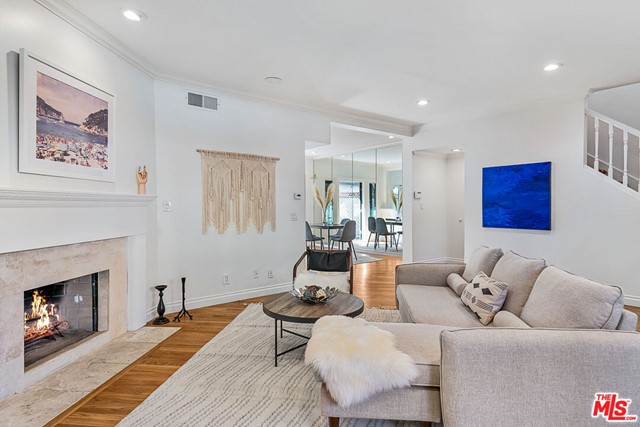 LOCATION, LOCATION, LOCATION! Welcome home to your gorgeous 3BR/2.5BA 1,582 sq. ft. townhome at 126 Montana Avenue -- one block from Ocean Avenue and Palisades Park!  Walk across Ocean Ave. to Palisades Park, and to the Montana Stairs down to the beach -- not to mention walk to all the hot spots along Ocean Ave.  This unit has a fresh, bright and beachy vibe with new natural oak hardwood floors, fresh white paint and LED lighting.  Large all-stainless kitchen w breakfast bar, spacious dining and living room w gas fireplace.  TWO patios on the first level -- front and back to enjoy the Santa Monica sun!  Upstairs are three bedrooms -- two guest beds w hallway bath and spacious primary en suite w northern exposure has 14' vaulted ceilings, walk-in closet, jetted tub and large shower.  W/D in private two-car side-by-side garage. The townhouse is located in a small five-unit building, low HOA, and two-car direct access garage as well as gated garage access to the building.