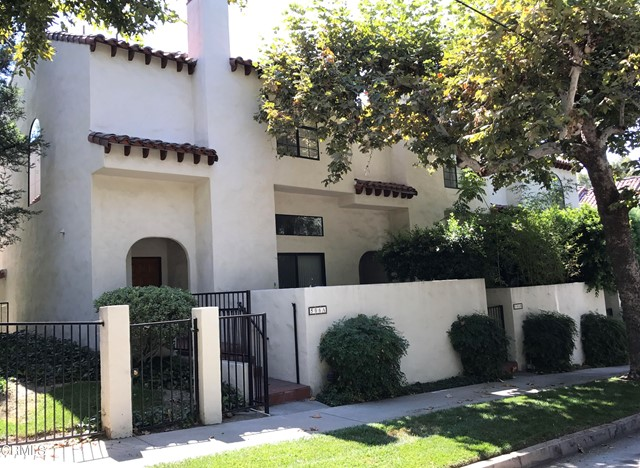 Gorgeous San Pasqual townhouse.  The bright living room with fireplace opens to the private patio.  Powder room off the entry.  Step up formal dining room.  Large modern kitchen complete with a breakfast area.  Two spacious master suites upstairs.  Two cars attached garage with built-in storage cabinets.  The complex offers a swimming pool, spa and meeting room.