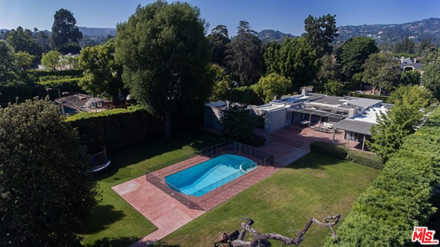 Large sprawling lot located on the coveted 700 block of Crescent in the heart of Beverly Hills, once the famed estate of Doris Day. This prime piece of real estate is perfect for any owner, user, or developer. 4,309 sq ft home is currently leased for $17,000 a month through June. Property is in plan check and scheduled for approval in June 2021 to build a 12,000 sqft house with a 1,000 sqft guest house designed by the esteemed luxury architect Ken Ungar. A lot and a half comprising a width of 120 feet and approximately 30,000 feet total. This is a rare opportunity to build a brand new home in the most desirable location. Saving up to a year of time, by close of escrow buyer will obtain plans and permits RTI.
