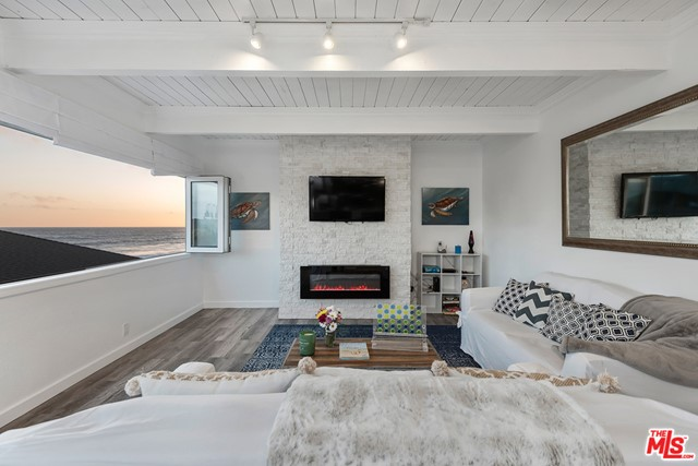 This serene, recently remodeled West Malibu home in the gated community of The Shores is a true coastal oasis. The open floor plan with seamless flow between the rooms and folding picture windows allow the ocean breezes to circulate throughout the 1,800 square feet of living space. Enjoy a true Chefs kitchen with Viking appliances, custom cabinetry, and a chic tiled backsplash. The home offers two airy, spacious bedrooms with luxurious bathrooms, plus a separate bonus guest suite with full bath and expansive patio that can easily be used for a rental. The coveted community also boasts basketball and tennis courts - and, best of all, direct access to two of Malibus world-famous beaches.