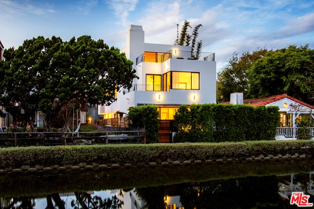 In a world-renowned neighborhood of awe-inspiring homes, this sophisticated 3-level architectural on the historic Venice Canals captivates and enchants. Designed by the distinguished architect, William R Pauli, AIA, the home boasts 10ft ceilings, walls of glass, and a preferred south-facing exposure. The open floorplan allows an easy flow from the cook's kitchen through the great room out to the inviting front deck and yard; ideal for canal-side al fresco dining. The 2nd level features a spectacular master suite replete with a fireplace, balcony overlooking the canal, walk-in closet, and a luxurious bathroom with oversized shower and stone-clad tub. An office nook and 2 additional bedrooms complete the 2nd level. The 3rd level is an exceptional and flexible space with extraordinary views, 2 fabulous decks, and a full bathroom; prime for a media room, den, or extra bedroom.