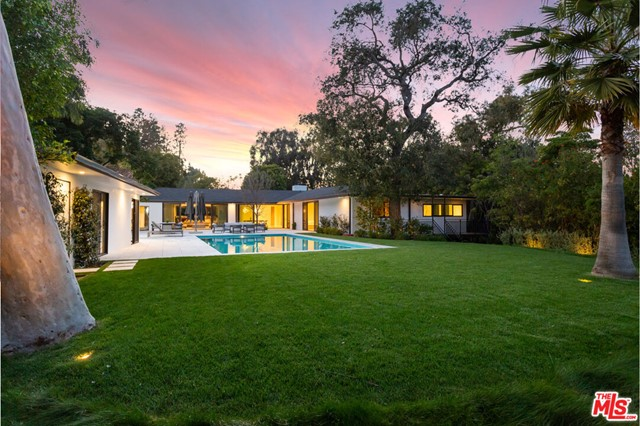 Originally created in 1942 by noted architect Sumner Spaulding, then taken down to the framing and meticulously modernized, expanded and artfully upgraded with the finest materials just last year; this sprawling single story home is a rare offering indeed. Positioned amongst over 100 mature trees on an elevated 1 acre parcel, you will find this privately secluded residence. A luxurious living space offering a total of 7 bedrooms, 7.5 baths, encompassing a main house, large pool/guest house and a spacious garage with a well appointed guest studio attached. Huge floor to ceiling windows and sliding glass doors open to lush gardens with soaring trees, flat, grassy grounds, a large sparkling pool and walking trail. Gracefully sited above the street and up a sweeping driveway with motor court, this special residence also offers views of Holmby Park and a peek into the Los Angeles Country Club golf course. This property has been designed to be a private paradise within one of LA's most prestigious and vibrant neighborhoods adjacent to some of the most renown Holmby Hills estate properties, beloved Holmby Park and the Armand Hammer Golf Course at LACC. Minutes to Beverly Hills, Century City and Westwood. This offering is truly an oasis of beauty, refinement and peace, just waiting to be enjoyed.