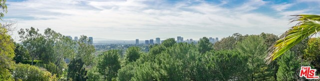 Unique and rare opportunity to own a 1.3 acre private promontory in the cul de sac on prestigious Tower Rd. Great views of the city and ocean from this double lot property, one lot in city of Beverly Hills and one in BHPO with BH city services and Los Angeles building codes. Massive amount of flat land with the option to create much more. This coveted site is surrounded by major estates on one of the most beautiful verdant streets in Beverly Hills. Please verify all building code issues with professionals. This property is a teardown. The pool is not habitable. Land value only