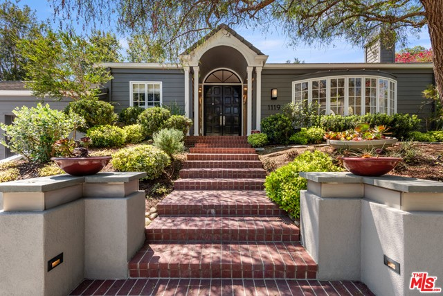 Traditional charm illustrates this custom home home located on a serene cul-de-sac street in the highly sought out Pacific Palisades. Greeted with openness and elegance when you walk through the door, the style depicts indoor/ outdoor living at its absolute best. The flow of the property takes you to a fabulous and spacious family room adjacent to the gourmet kitchen opening to a beautiful private garden area. French doors from the family room open wide to a secluded patio perfect for entertaining with family and friends or winding down in a more intimidate setting. Gracious in every way, is this 4 bedroom, 4.5 Bath with office/study. The large step down living room and walk up bedroom area adds dimension to this one story beauty. Office could easily be 5th bedroom. This Pacific Palisades gem is in beautiful move in condition. A must see!