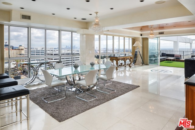 Beautiful east facing penthouse unit with outdoor sundeck in the famed Versailles Tower. This three-bed, four bath unit features 3,580 SqFt and a light, bright and open floor plan thoughtfully designed to showcase California's indoor-outdoor lifestyle. Sweeping views of the Hollywood Sign and Griffith Observatory to the North, Downtown, Los Angeles to the East and Century City to the West. The fully equipped kitchen with large preparation island and adjacent wet bar with integrated seating is a focal point of the condo. It opens to an elegant dining space, naturally illuminated by floor to ceiling windows and panoramic bi-fold doors that invite guests to the rear outdoor space. Mid-century building offers 24-hour door man, valet parking, exercise facility, game room, swimming pool and sauna. Moments away from The Hollywood Roosevelt and Runyon Canyon Park.