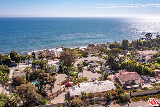Live the quintessential California lifestyle in the Broad Beach neighborhood with head-on ocean views and direct beach access across from the Bunnie Lane cul-de-sac. This charming light & bright, single-story home has vaulted ceilings and plank-style tile flooring throughout. A large ocean-facing garden patio off the living room and an open floorplan create a lovely indoor-outdoor living space. Broad Beach Rd. utilities are underground so the view is not obstructed with telephone wires as it is elsewhere in Malibu. The septic has been upgraded with a new 1500 gallon tank and 2021 City of Malibu OWTS Operating Permit. With this once-in-a-lifetime view & beach access, a bit more modernization would transform the property into a 21st-century showpiece! A paradise for all kinds of outdoor activities, you'll love this western Malibu location which offers many community amenities within a 5 miles radius: Trancas County Market, Malibu Middle & High School complex, Point Dume Elementary & Point Dume Village, Zuma Beach, Equestrian Park, Trancas Community Dog park, State parkland trails, and numerous surfing spots along the coast.