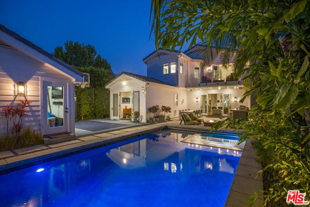 Extensively upgraded traditional home with a contemporary flair, constructed brand new in 2014. There have been over $750,000 of upgrades since the house was built Set in the highly acclaimed and desirable Franklin School District of North Santa Monica, the property is set on a beautiful tree-lined street and gated from the sidewalk with beautiful mature professional designer landscaping. An ideal floor plan that consists of five bedroom suites (four bedrooms up & one bedroom down). The interior is almost 4,600 SqFt and set on a large approximate 8,000 Sq.Ft. flat lot. The main level includes a formal entry, formal living, formal dining, library/office, powder room & large-scale family room plus kitchen combo that opens to an expansive magical and secluded backyard with professional mature landscaping, lighting, pool, spa, waterfall, sports court, outdoor kitchen, and detached garage. The open kitchen with top-of-the-line Viking stainless steel appliances and huge center island sits near a wine collectors state of the art highly customized temperate controlled professional wine room with seemingly endless wine bottle storage capacity. The laundry room and main level bedroom suite (which currently serves as a gym), both rooms have separate entrances. There's a second family room upstairs along with a bonus room adjacent to the master bedroom that could be used as a nursery or additional office. The master suite romantically gazes out over the lushly landscaped backyard through french doors, expansive deck, and fire pit. The house is conveniently set near Erewhon, boutique Montana Ave. shopping/restaurants, the Brentwood Country Mart, top-rated schools, beach, hiking, bike paths & all that Westside beach living has to offer.